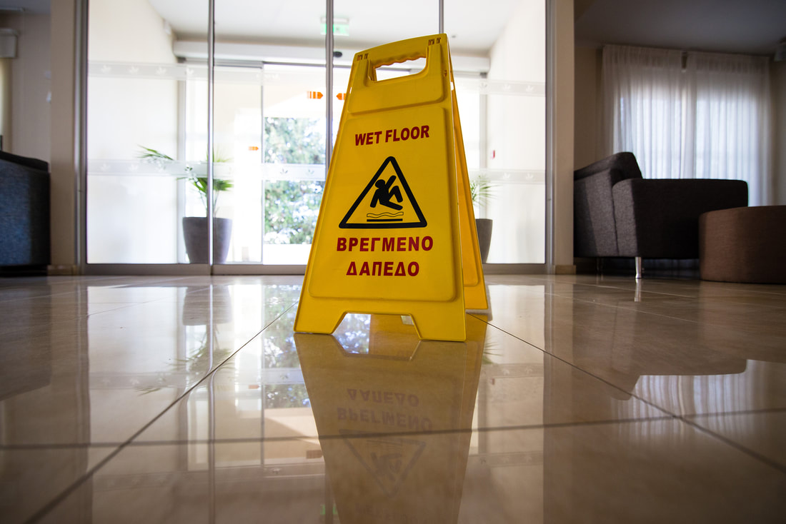 Safety sign to notify the floor is wet after a deep tile cleaning
